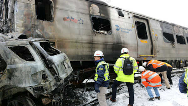 "<div class=""meta image-caption""><div class=""origin-logo origin-image none""><span>none</span></div><span class=""caption-text"">A Metro-North train slammed into a vehicle on the tracks Tuesday night in Valhalla. (Photo courtesy Justin Kaback)</span></div>"