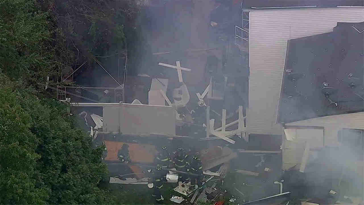 Firefighters, gas officials and investigators are on the scene of an apparent house explosion in New Jersey.