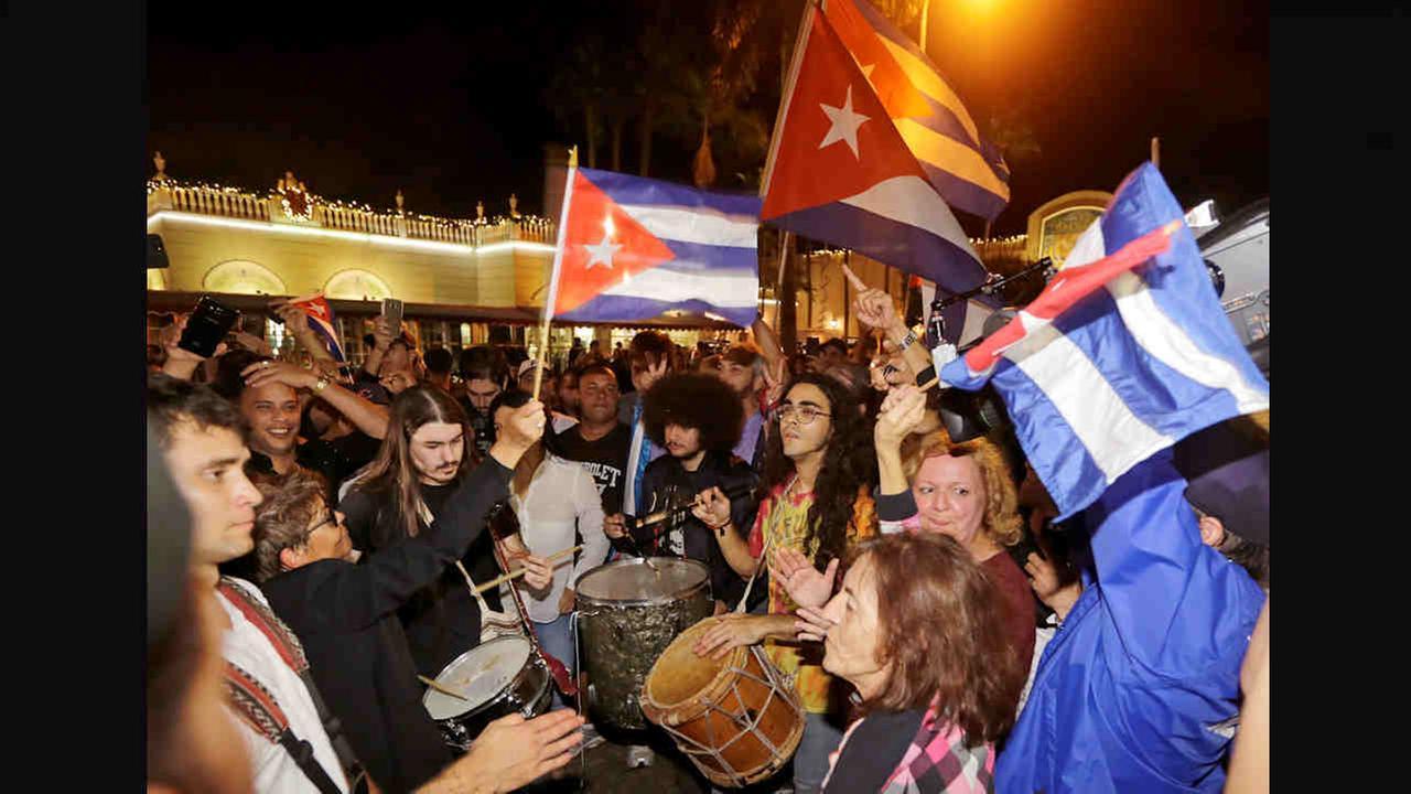 Cuban-Americans celebrate the death of Fidel Castro, Saturday, in the Little Havana area in Miami.Alan Diaz