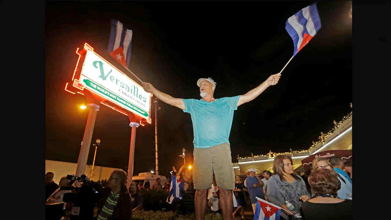 A Cuban-American celebrates the death of Fidel Castro Saturday, in the Little Havana area in Miami.