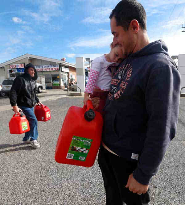 "<div class=""meta image-caption""><div class=""origin-logo origin-image none""><span>none</span></div><span class=""caption-text"">Chris Ferrone, right, carries his 3-year-old daughter Kora as she holds on to a five-gallon gas can while waiting in line to fill up at a gas station in Toms River, N.J. Nov.1 '12 </span></div>"