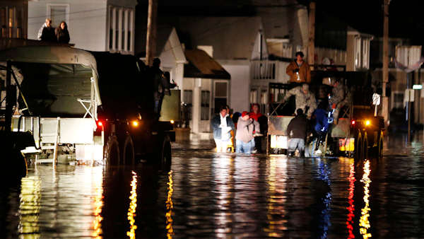 "<div class=""meta image-caption""><div class=""origin-logo origin-image none""><span>none</span></div><span class=""caption-text"">Rescue workers help stranded people out of their flooded homes in Seaside Heights, N.J., following the arrival of superstorm Sandy, Tuesday, Oct. 30, 2012.  (AP/Julio Cortez)</span></div>"