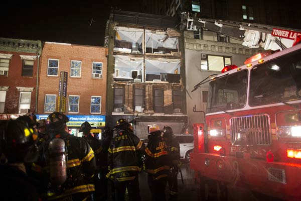 "<div class=""meta image-caption""><div class=""origin-logo origin-image none""><span>none</span></div><span class=""caption-text"">Firefighters respond at the scene where the facade of a four-story building on 14th Street and 8th Avenue collapsed onto the sidewalk Monday, Oct. 29, 2012, in New York. (AP Photo/John Minchillo)</span></div>"