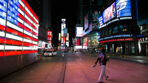"<div class=""meta image-caption""><div class=""origin-logo origin-image none""><span>none</span></div><span class=""caption-text"">A lone pedestrian walks through an empty Times Square early, Monday, Oct. 29, 2012, in NYC. Hurricane Sandy forced the shutdown of mass transit, schools and financial markets.  (AP/John Minchillo)</span></div>"
