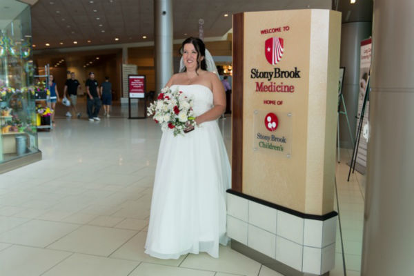 "<div class=""meta image-caption""><div class=""origin-logo origin-image ""><span></span></div><span class=""caption-text"">37-year-old James Lauricella and 41-year-old Kimberly Mikucki of Holtsville said their wedding vows Saturday in Chapel at Stony Brook University Hospital.  (WABC Photo)</span></div>"