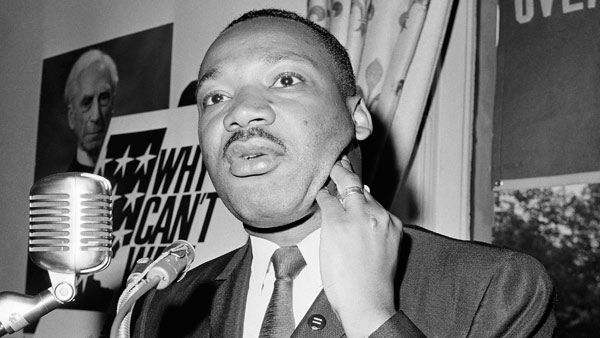 <div class='meta'><div class='origin-logo' data-origin='none'></div><span class='caption-text' data-credit='AP'>The Rev. Martin Luther King of the Southern Christian Leadership Conference, holds news conference today March 26, 1964 at the capital</span></div>