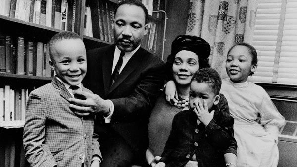 <div class='meta'><div class='origin-logo' data-origin='none'></div><span class='caption-text' data-credit='AP'>Dr. Martin Luther King Jr. and his wife, Coretta Scott King, sit with three of their four children in their Atlanta, Ga, home, on March 17, 1963</span></div>