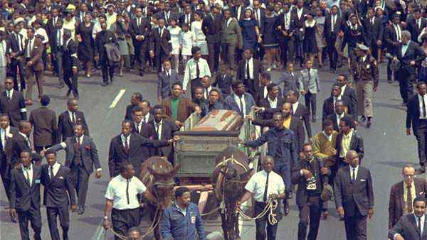 <div class='meta'><div class='origin-logo' data-origin='none'></div><span class='caption-text' data-credit='AP'>A brace of plow mules drawing the farm wagon bearing the mahogany casket of Dr. Martin Luther King, Jr., on April 9, 1968.</span></div>