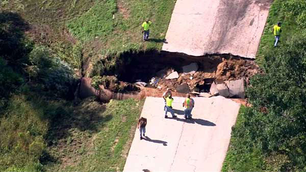 Two people were hurt when a car drove into a sinkhole in unincorporated Burlington Township. <span class=meta>WLS Photo</span>