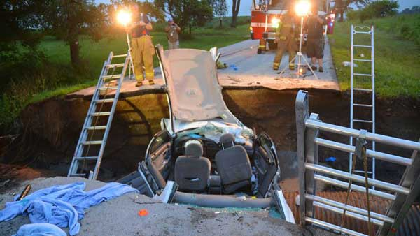 Two people were hurt when a car drove into a sinkhole in unincorporated Burlington Township. <span class=meta>RadioMan911.com</span>