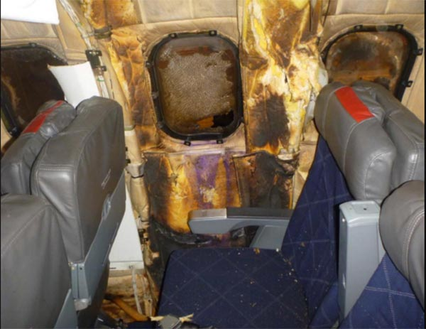 <div class='meta'><div class='origin-logo' data-origin='WLS'></div><span class='caption-text' data-credit='National Transportation Safety Board'>Fig. 59: Charred insulation blankets and melted window at seat 30</span></div>