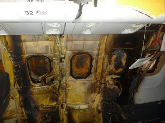 <div class='meta'><div class='origin-logo' data-origin='WLS'></div><span class='caption-text' data-credit='National Transportation Safety Board'>Fig. 60: Charred insulation at seats 33 through 34</span></div>
