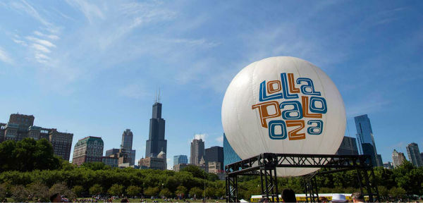 A Lollapalooza balloon is seen against the Chicago skyline at the 2013 Lollapalooza music festival. <span class=meta>AP Photo/Scott Eisen</span>