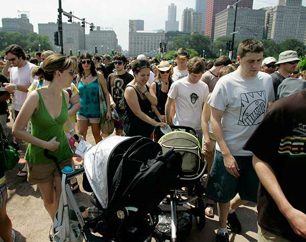 Women push stroller sthrough the crowd at Lollapalooza 2008 <span class=meta>AP Photo/Russel A. Daniels</span>
