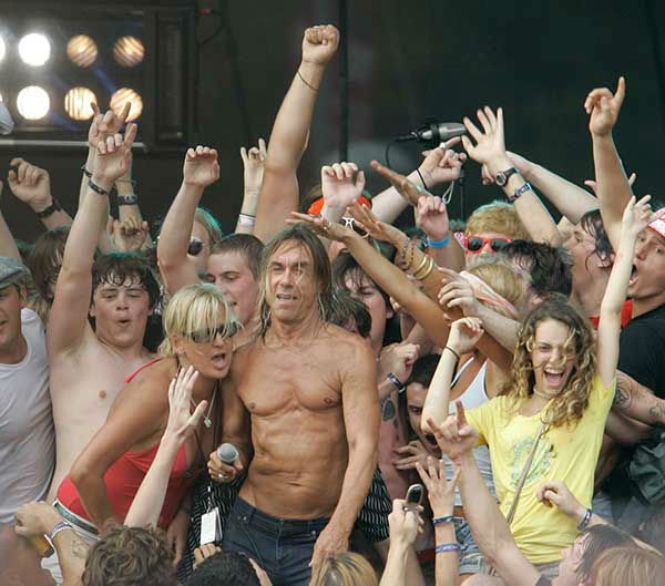 Iggy Pop invites fans on stage during his performance at Lollapalooza 2007 <span class=meta>AP Photo/Brian Kersey</span>