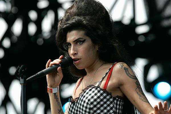 Amy Winehouse performs at Lollapalooza 2007 <span class=meta>AP Photo/Brian Kersey</span>