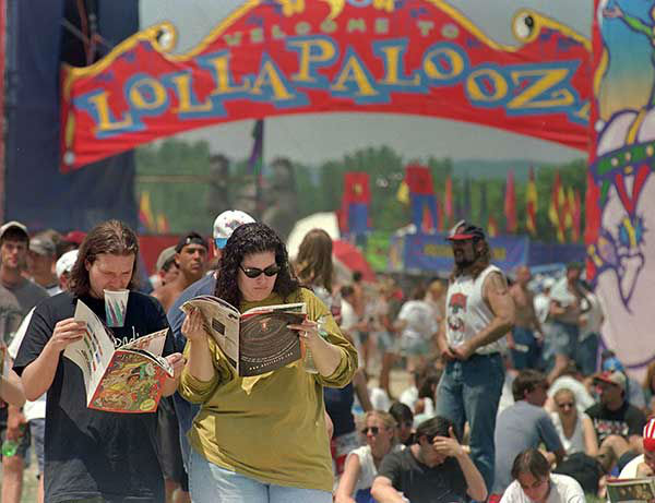Two attendees study the lineup as they decide who to see next at Lollapalooza 2006. <span class=meta>AP Photo/TOBY TALBOT</span>