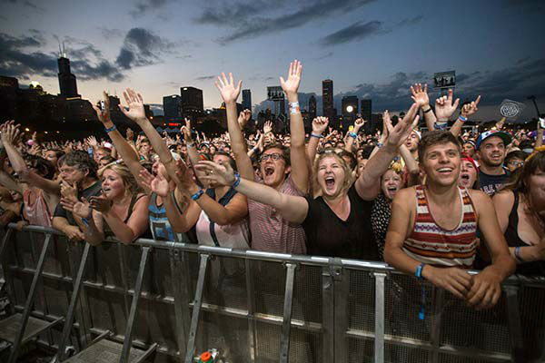 Fans watch Mumford & Sons perform at Lollapalooza 2013. <span class=meta>AP Photo/Scott Eisen</span>