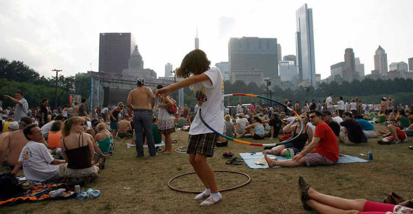 A young fan dances with a hula hoop at Lollapalooza 2009 <span class=meta>AP Photo/JOHN SMIERCIAK</span>