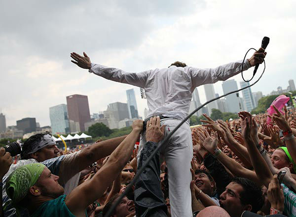Matt Shultz of Cage The Elephant performs at Lollapalooza in Chicago's Grant Park on Sunday, Aug. 3, 2014. <span class=meta>Steve C. Mitchell/Invision/AP</span>