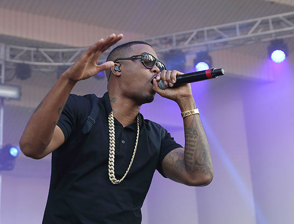 Nas performs at Lollapalooza in Chicago's Grant Park on Saturday, Aug. 2, 2014. <span class=meta>Steve C Mitchell/Invision/AP</span>