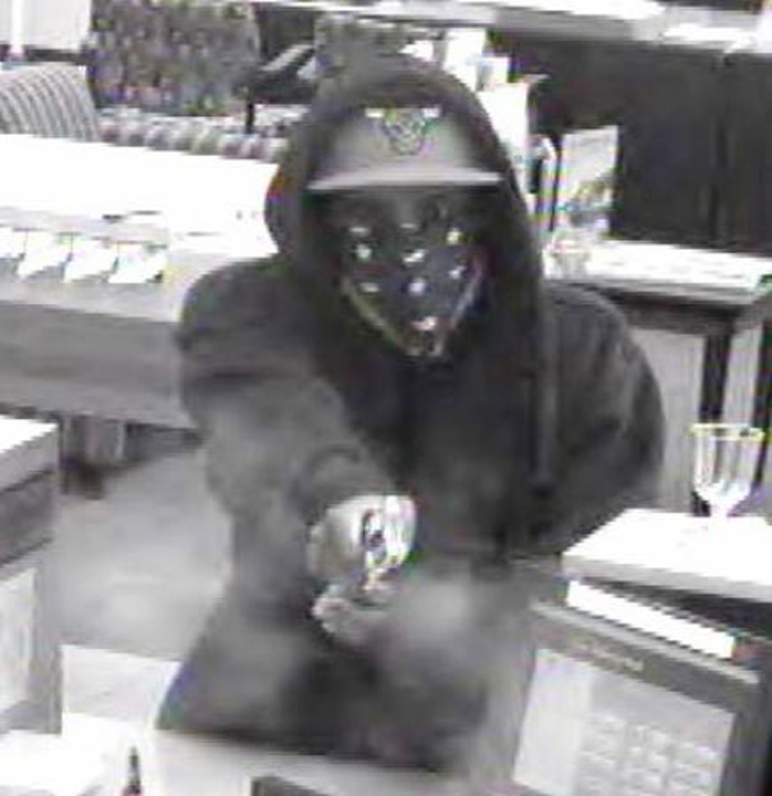 FBI officials released this image of a man wanted in a robbery and shooting at a Bolingbrook bank on August 11, 2014. <span class=meta></span>