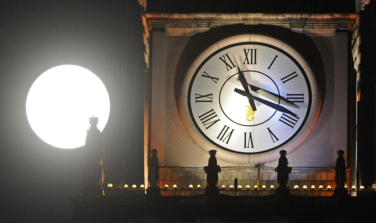 "<div class=""meta image-caption""><div class=""origin-logo origin-image ""><span></span></div><span class=""caption-text"">A supermoon rises next to a clock on top of the Palace of Culture in Warsaw, Poland, Sunday, Aug. 10, 2014. (AP Photo/Alik Keplicz)</span></div>"
