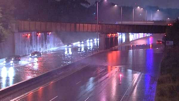 <div class='meta'><div class='origin-logo' data-origin='none'></div><span class='caption-text' data-credit='WLS Photo'>Heavy rain falling across the Chicago area caused delays on local expressways, public transit and flash flooding on Friday.</span></div>