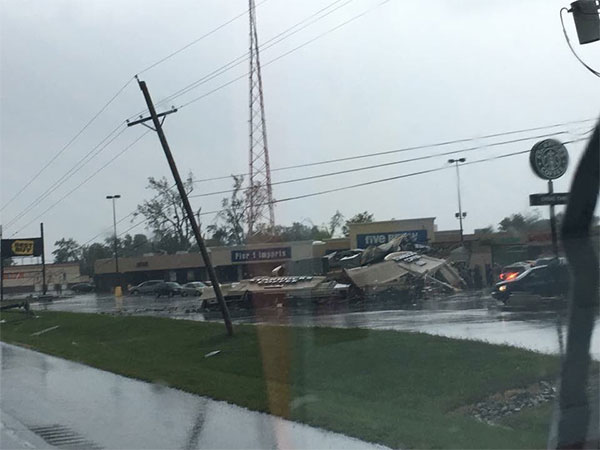 <div class='meta'><div class='origin-logo' data-origin='none'></div><span class='caption-text' data-credit='Courtesy of Samantha Wnek'>A standalone Starbucks collapses as a result of a tornado in Kokokmo, Ind.</span></div>