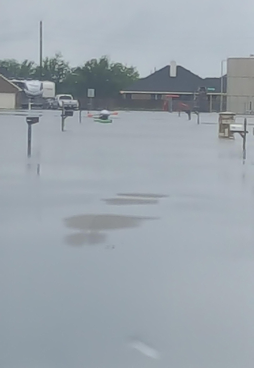 "<div class=""meta image-caption""><div class=""origin-logo origin-image none""><span>none</span></div><span class=""caption-text"">A street in the Needville Rosemeadow Subdivision on Hurricane Harvey. (Amber Atkinson)</span></div>"