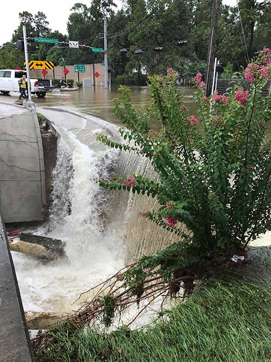 <div class='meta'><div class='origin-logo' data-origin='none'></div><span class='caption-text' data-credit=''>Feeder road collapsing onto Beltway 8 on Aug. 27, 2017. (Andrew Holland)</span></div>