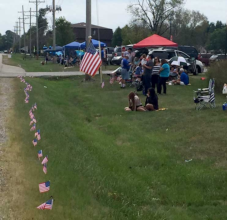 "<div class=""meta image-caption""><div class=""origin-logo origin-image wls""><span>WLS</span></div><span class=""caption-text"">Along the funeral procession route for Fox Lake Police Lt. Joe Gliniewicz.</span></div>"