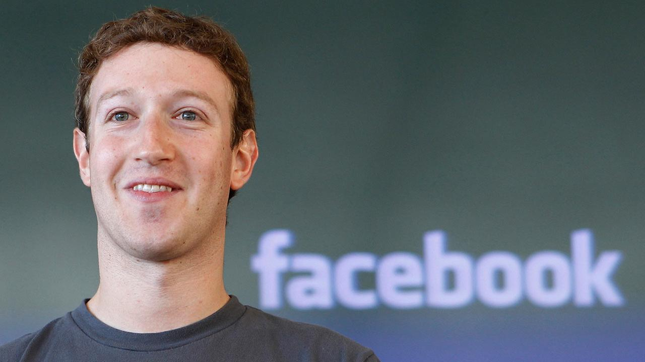 FILE - This Oct. 15, 2011 file photo shows Facebook CEO Mark Zuckerberg smiling during a meeting in San Francisco.