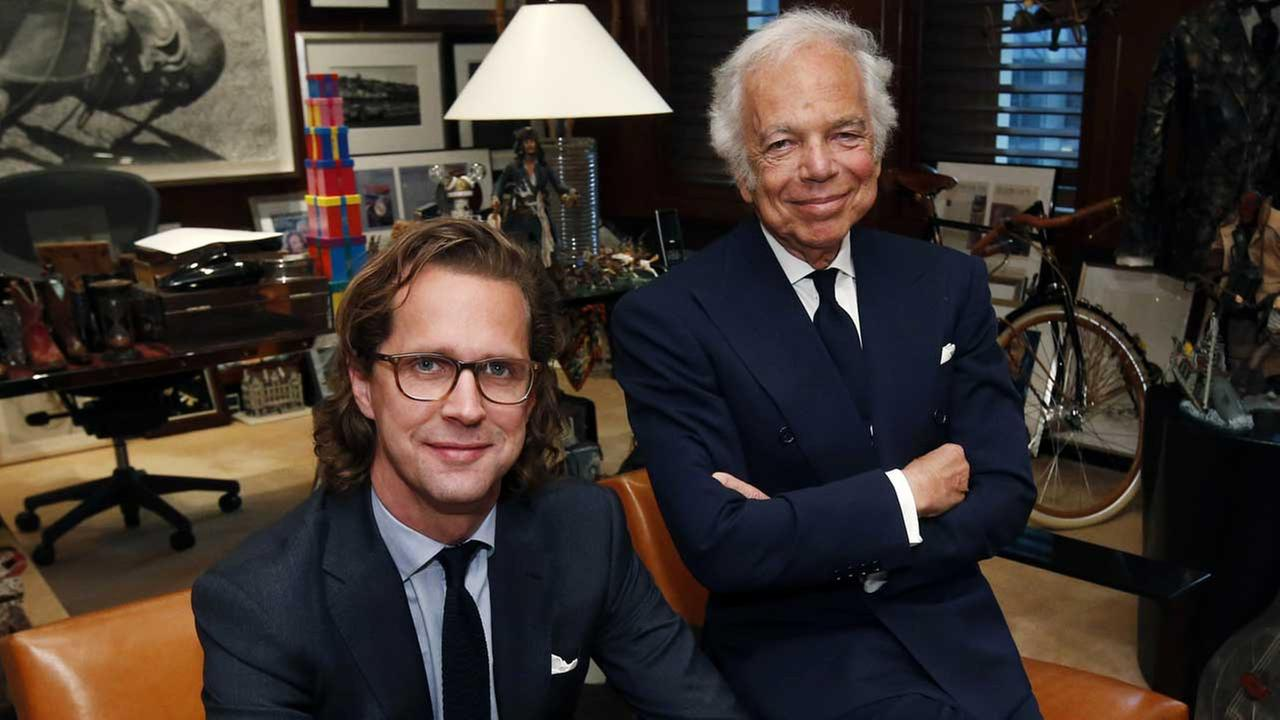 Designer Ralph Lauren, right, poses in his office with Stefan Larsson, global brand president for Old Navy, Tuesday, Sept. 29, 2015, in New York.