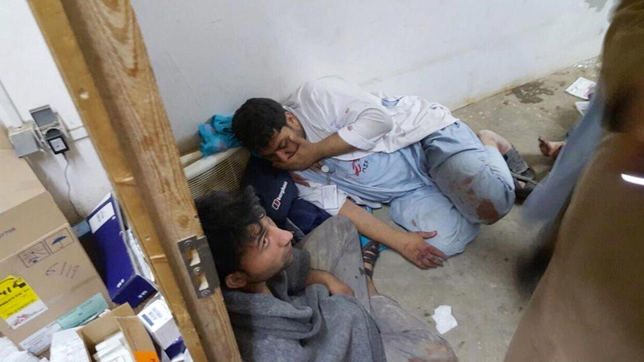 Injured, Doctors Without Borders staff are seen after an explosion near their hospital in the northern Afghan city of Kunduz on Oct. 3, 2015.
