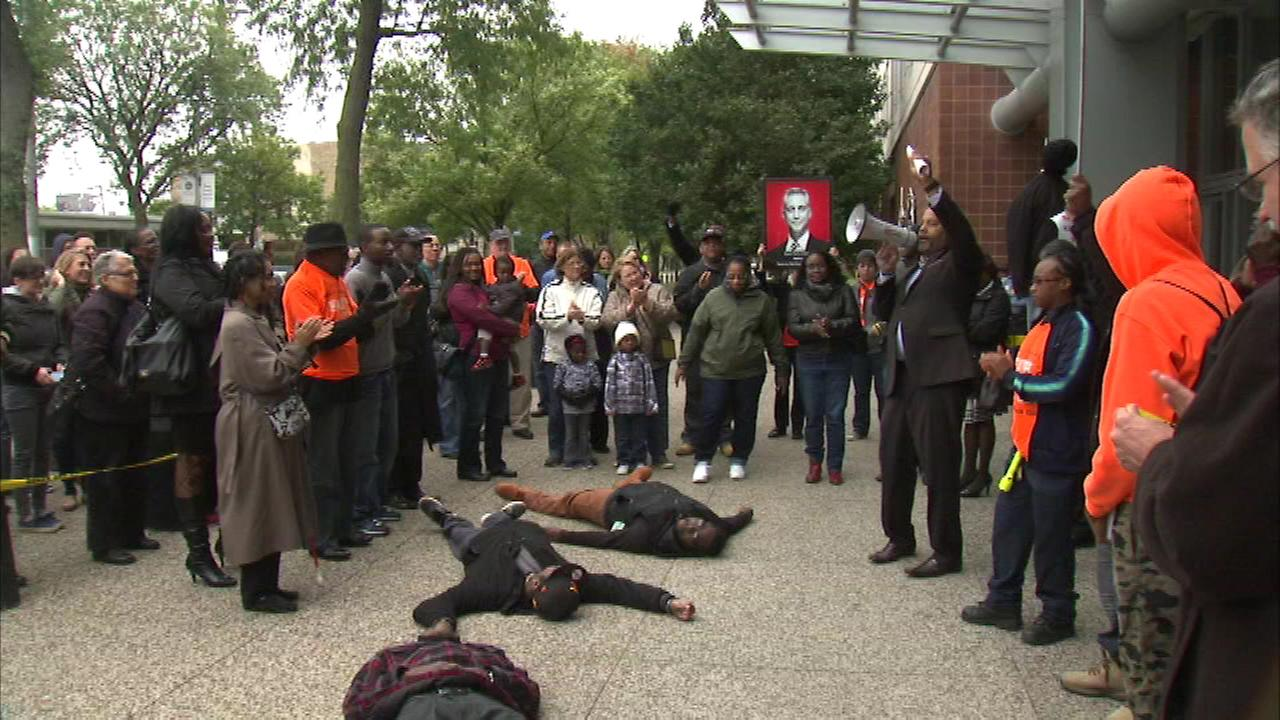 About 150 people gathered for a rally Saturday outside the Chicago Police Headquarters at 35th Street and Michigan Avenue.