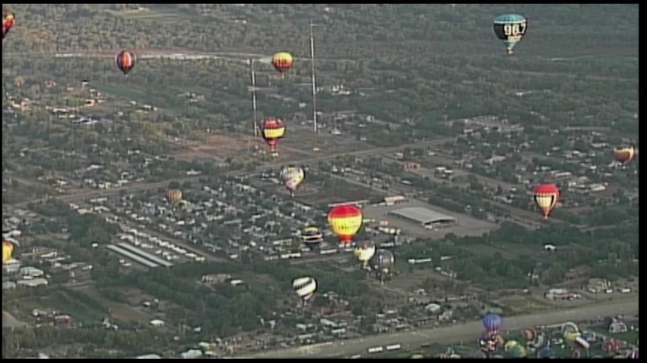 Tens of thousands of spectators swarmed the launch field Saturday for the first mass ascension of the 44th annual Albuquerque International Balloon Fiesta.