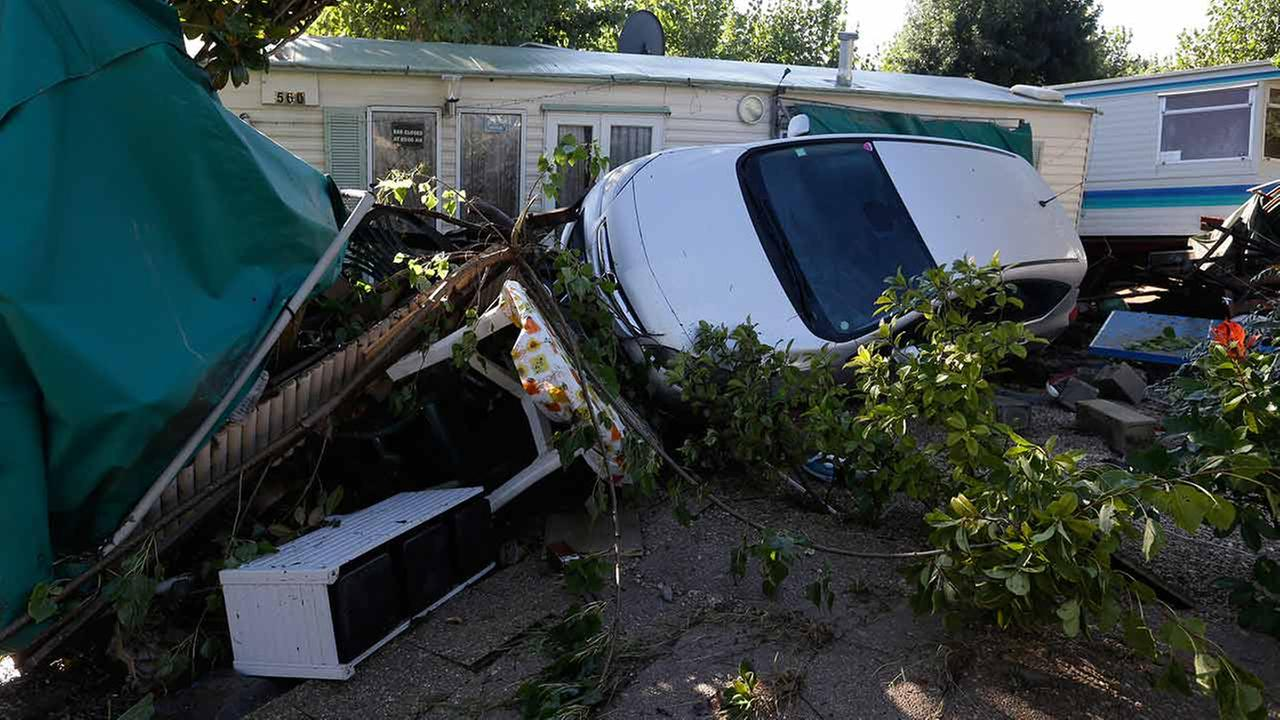 Debris and a damaged car are pictured in the campsite of Biot, near Cannes, southeastern France on Oct.4, 2015.