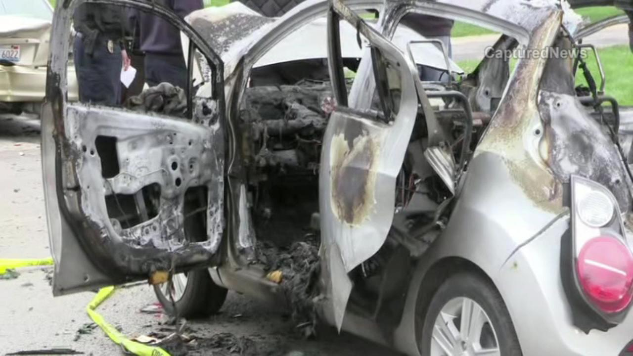 A driver was rescued from his burning car by a Good Samaritan in the western suburbs Sunday afternoon, fire officials said.