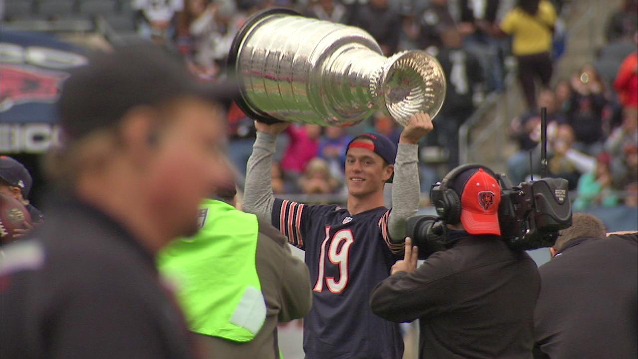 Blackhawks star Jonathon Toews shows off the Stanley Cup at Soldier Field Sunday.