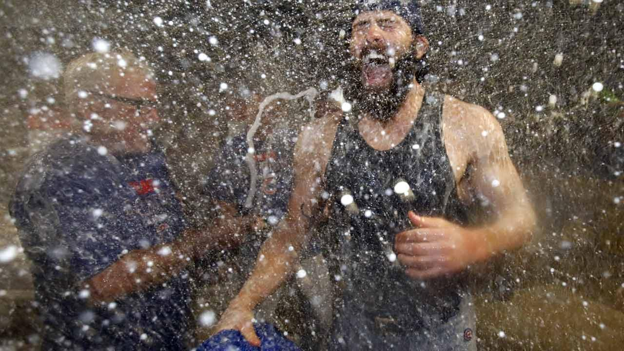 Chicago Cubs starting pitcher Jake Arrieta is doused by manager Joe Maddon and teammates after pitching a complete game against the Pittsburgh Pirates.