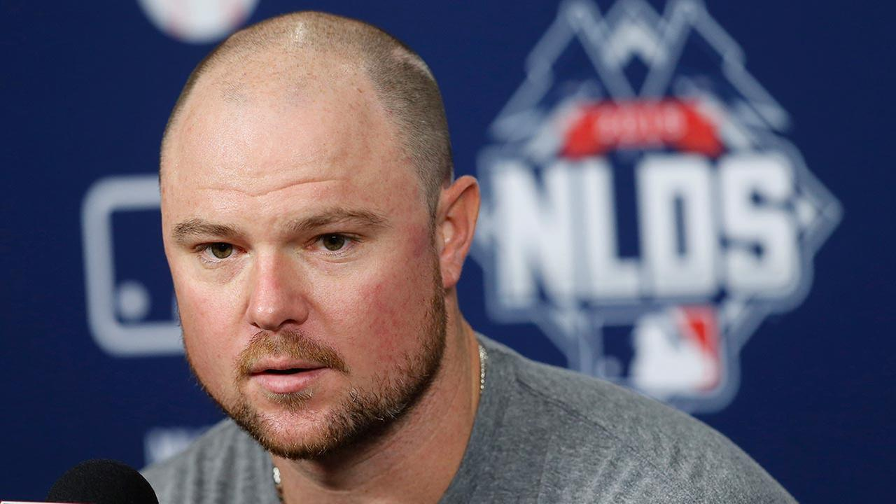 Chicago Cubs starting pitcher Jon Lester responds to a question during a news conference on Oct. 8, 2015, in St. Louis.
