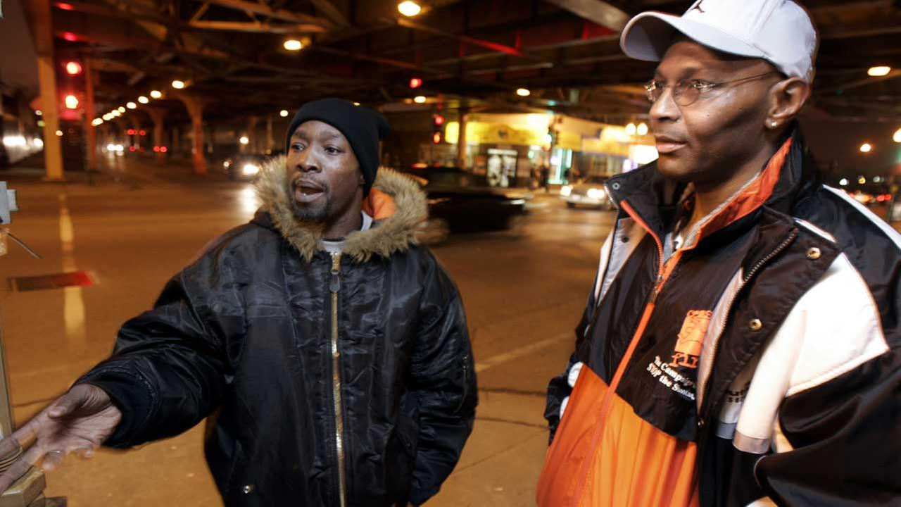 (FILE) Alphonso Prater, left, and Karl Bell, violence interrupters with CeaseFire.