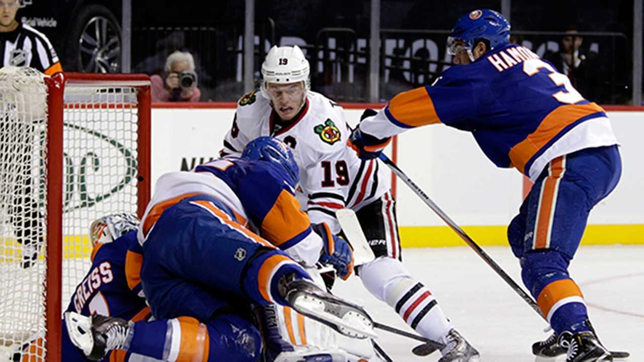 Blackhawks center Jonathan Toews (19) has his shot stopped by New York Islanders goalie Thomas Greiss in the first period during an NHL hockey game on Oct. 9, 2015, in New York.