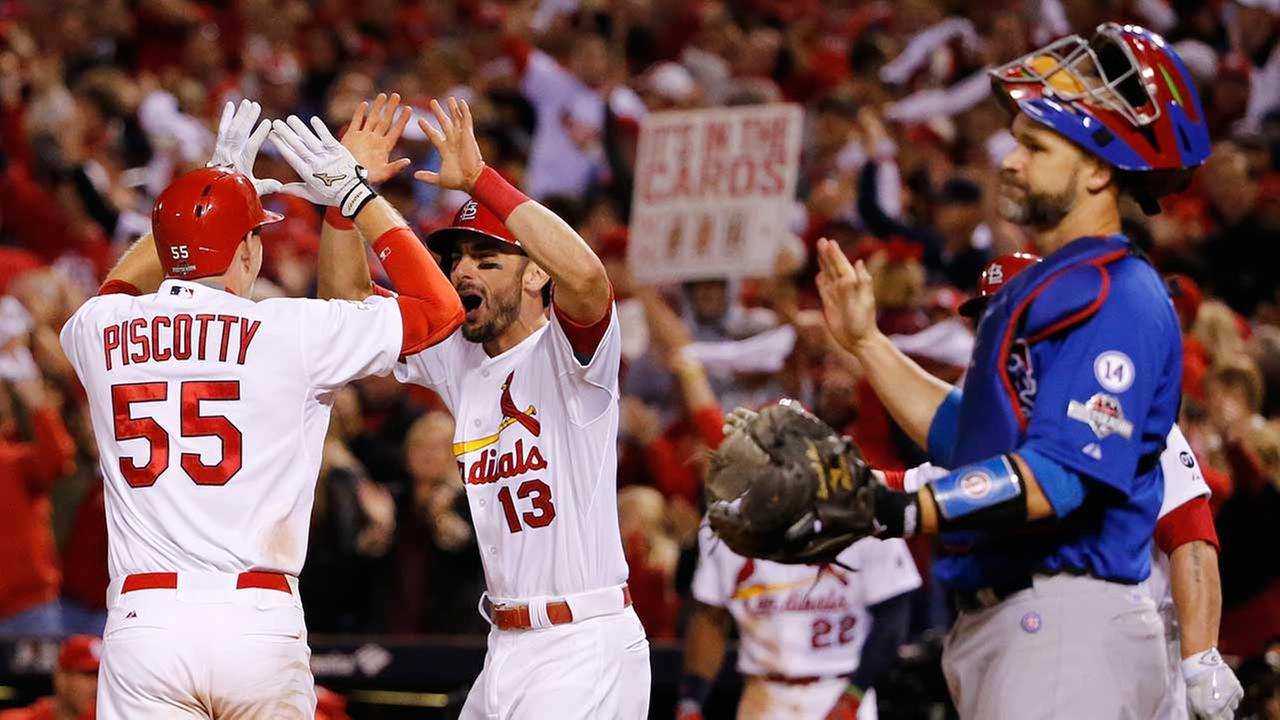 St. Louis Cardinals Stephen Piscotty celebrates with teammate Matt Carpenter after hitting a two-run home run during the eighth inning of NLDS Game 1 in St. Louis on Oct. 9, 2015.