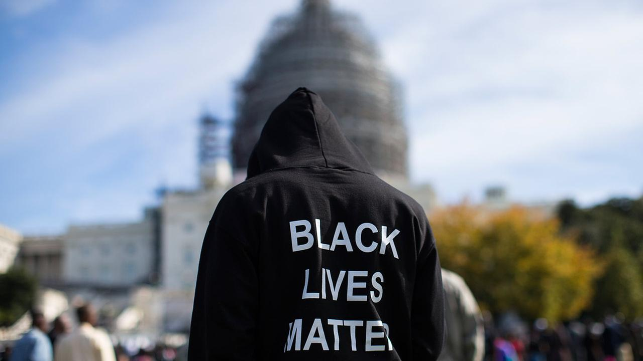 Neal Blair stands on the lawn of the Capitol building during a rally to mark the 20th anniversary of the Million Man March, on Capitol Hill, on Oct. 10, 2015 in Washington, D.C.