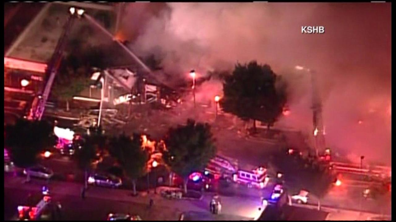 Two firefighters died after suffering injuries during a massive apartment fire in Kansas City, Mo.