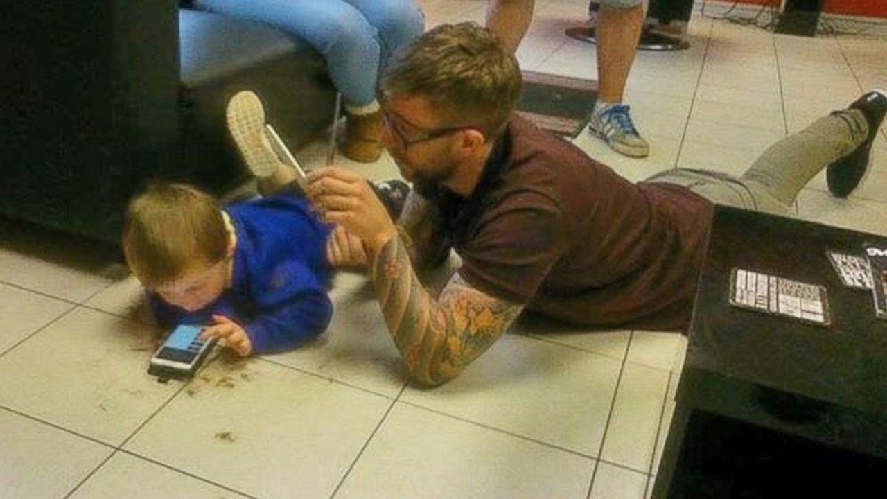 Barber lies on floor to give boy with autism his first for Give the floor