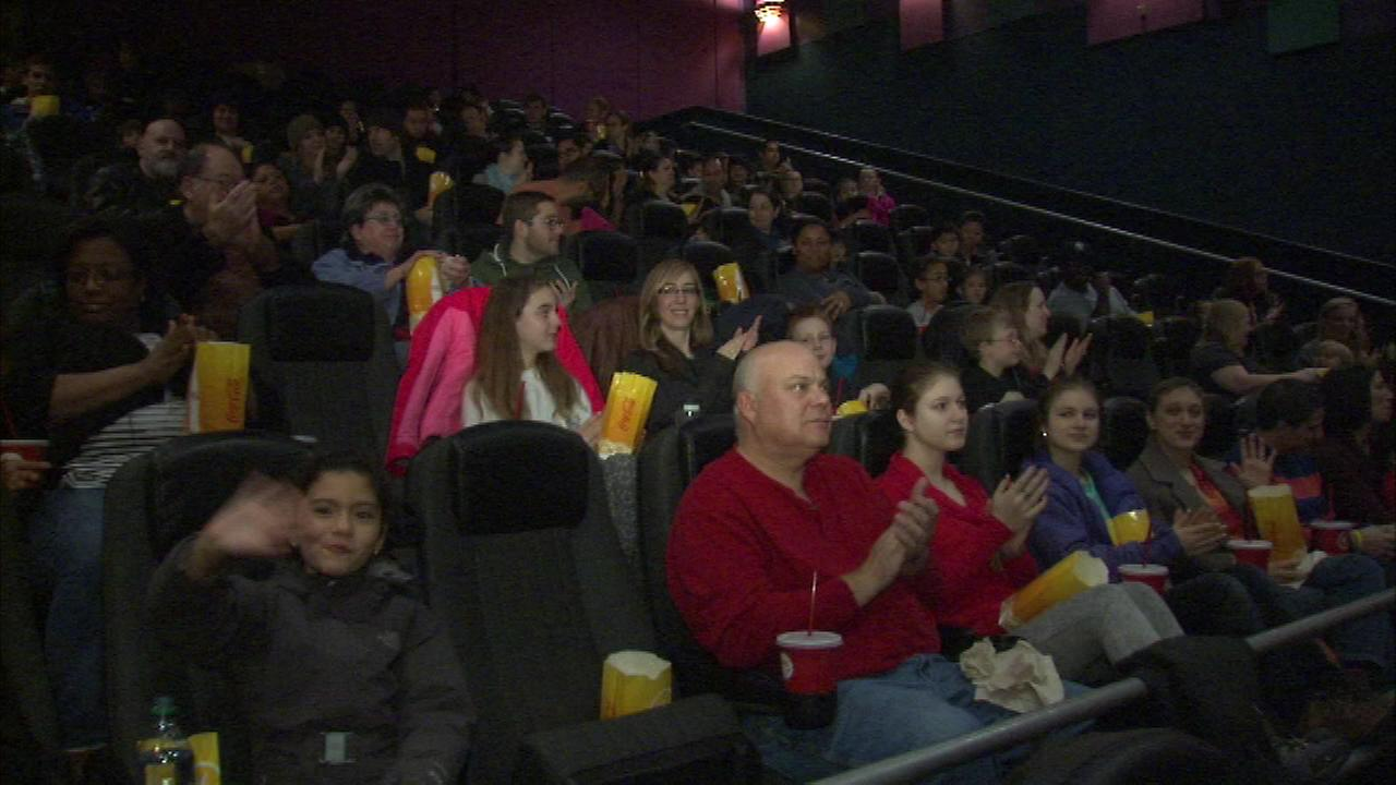 Staff and volunteers from the Greater Chicago Food depository and the Northern Illinois Food Bank were treated to a free screening of the new movie The Good Dinosaur Saturday.