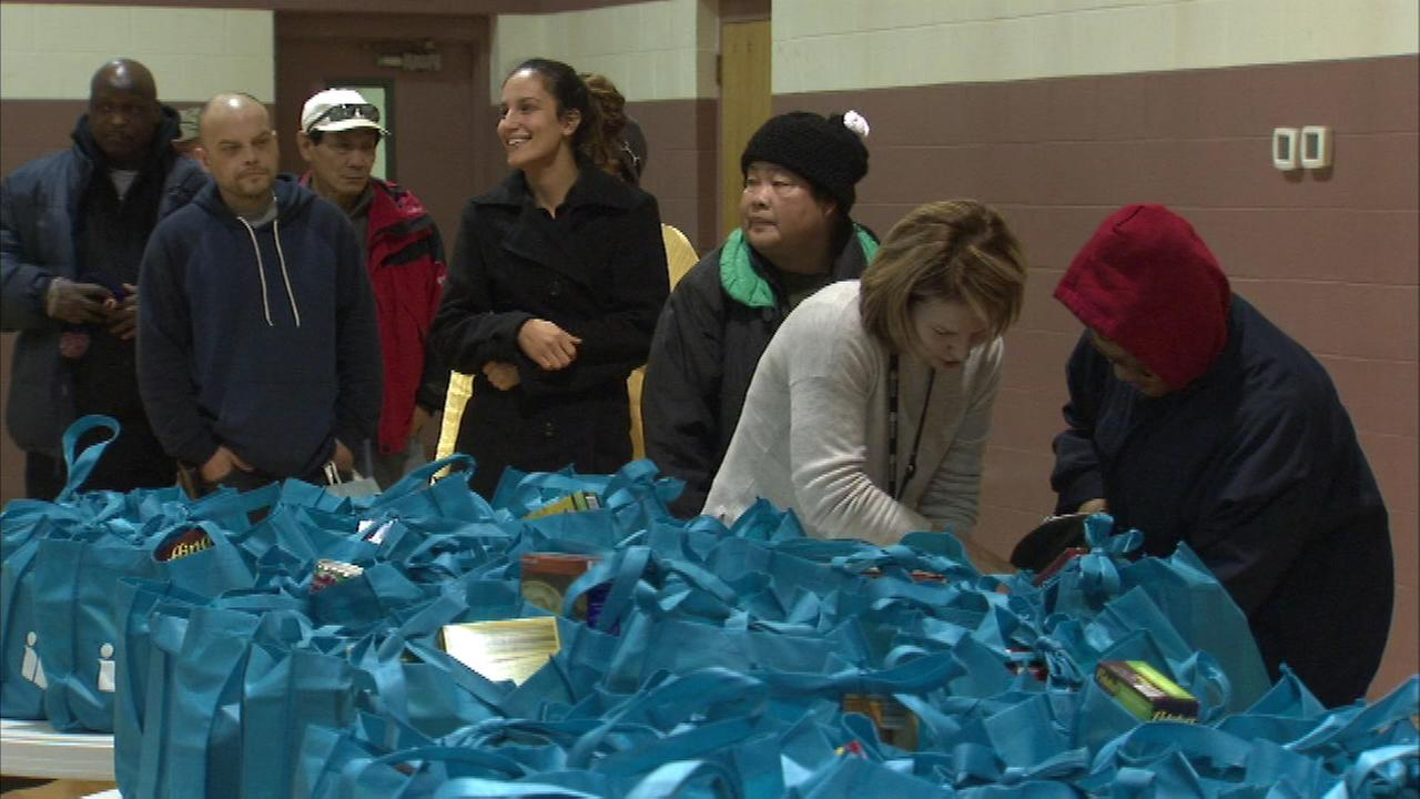 Reusable grocery bags filled with ham, vegetables, and macaroni and cheese were passed out at the Salvation Army on N. Ogden in Chicago.